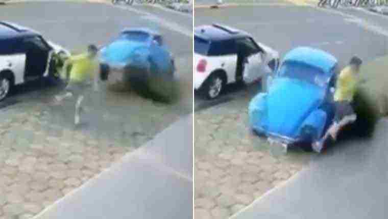 Homem escapa por um triz de fusca azul desgovernado